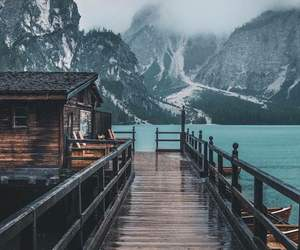 house, lake, and mist image