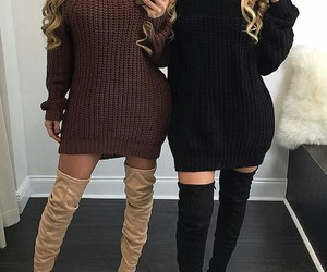black thigh high boots, white faux fur rugs, and black sweater dress image