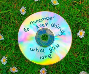 cd, daisies, and holo image