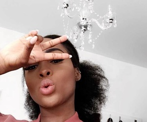Afro, eyebrows, and nails image