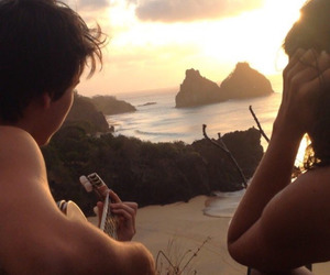 couple, beach, and guitar image