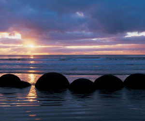 beach, boulders, and new zealand image
