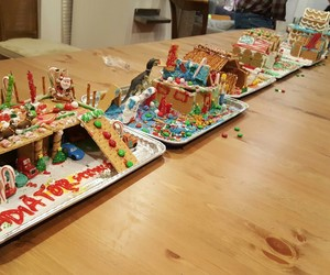 family and gingerbread houses image