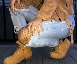 timberland boots, brown jackets, and light blue ripped jeans image