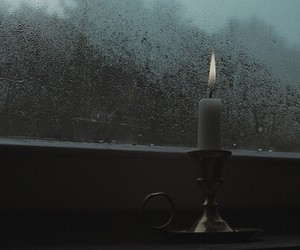 candle and rain image