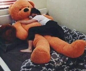 bed, teddy bear, and birthday gift image