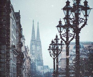 city, light, and snow image