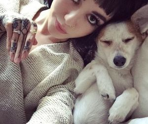 hannah snowdon, dog, and tattoo image