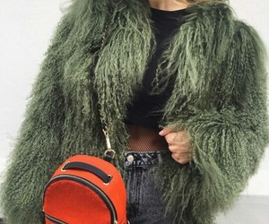 black fishnet tights, straight blonde hair, and green fur coat image