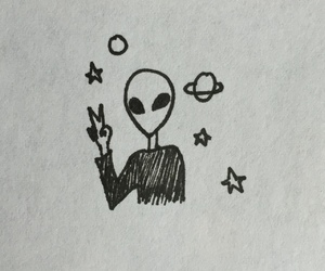 alien and planet image