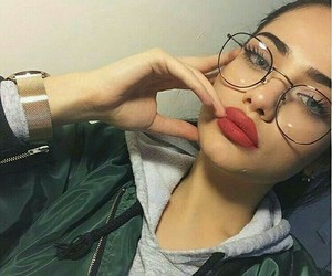 black glasses, red matte lipstick, and eyebrow goals image