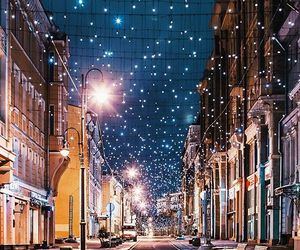 city lights, snow, and snowflakes image