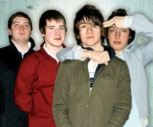 alex turner, nick o malley, and jamie cook image