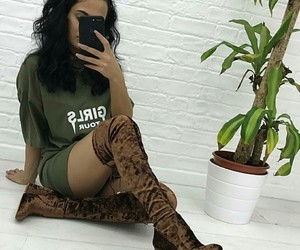 wavy black hair, velvet thigh high boots, and green t-shirts image