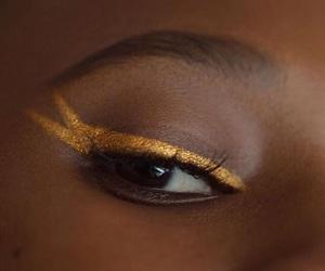 gold, eyeliner, and makeup image