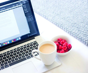 coffee, fruit, and laptop image