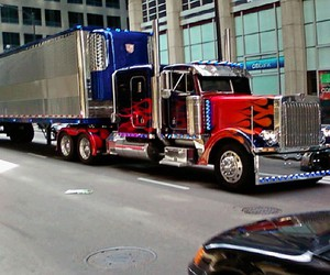 optimus prime, transformers, and truck image