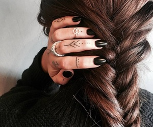 braids and tattoo image