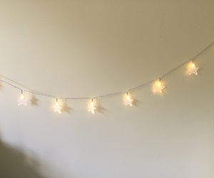stars, fairy lights, and yellow image