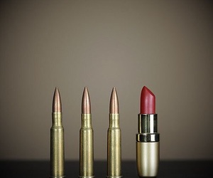 bullet, lipstick, and gun image