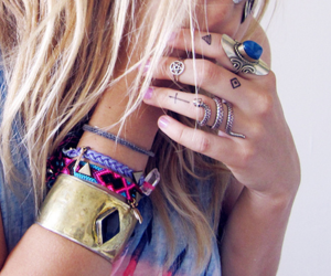 rings, bracelet, and tattoo image
