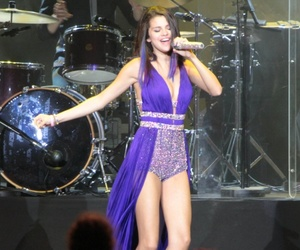 selena gomez and we own the night tour image