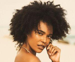 curly hair, natural hair shrinkage, and natural hair image