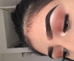 cat eye, estee lauder, and eyebrows image