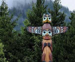native american and totem pole image