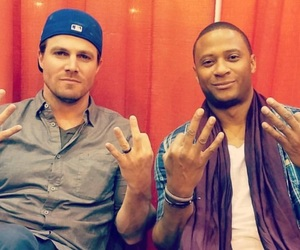 arrow, stephen amell, and david ramsey image