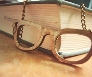 book, glasses, and necklace image