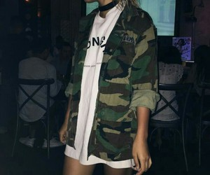camo jacket, black choker necklace, and white graphic t-shirts image