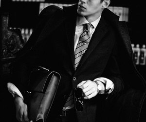 black and white, classy, and detective image