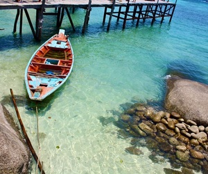 boat, crystal clear, and green image
