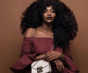 Afro, makeup, and purse image