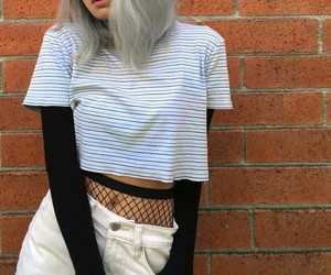 septum piercing, black fishnet tights, and white jeans image
