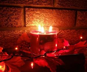 autumn, candle, and leaf image