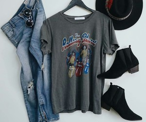 black ankle booties, grey graphic t-shirts, and blue ripped jeans image