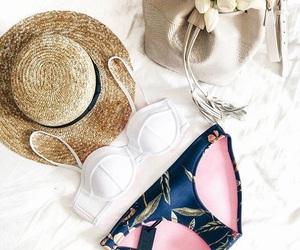 bikini, trianglswimwear, and clothing image