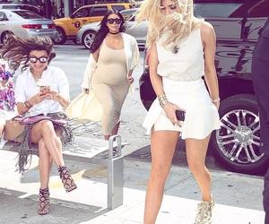 kim, kylie, and paparazzi image