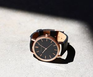 black, gold, and watch image