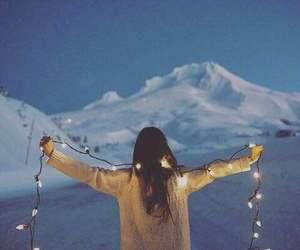 girl, light, and snow image