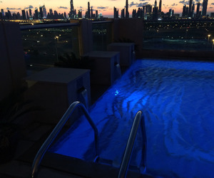 city, pool, and night image
