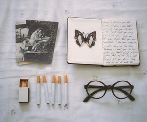 cigarette, book, and glasses image