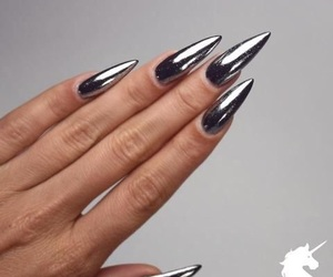 nails, silver, and stilettos image