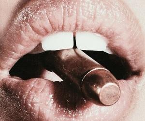 bullet, gun, and lipstick image