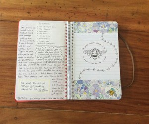 journals, notebook, and writes image