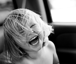 black and white, boy, and laugh image