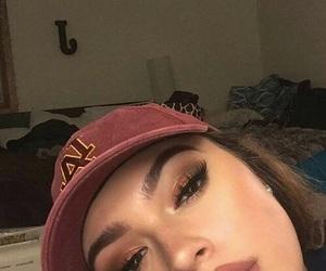 cap, eyebrow, and eyeliner image