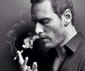 michael fassbender, smoking, and black and white image
